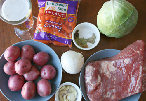 Crockpot Corned Beef and Cabbage ingredients placed on table