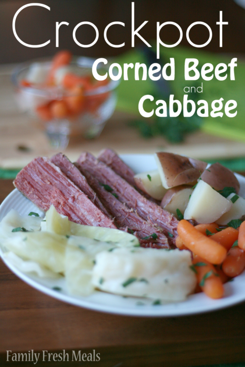 Crockpot Corned Beef and Cabbage served on a white plate