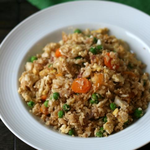 Cauliflower Fried Rice. Looks like rice, tastes like rice, but it's cauliflower! - FamilyFreshMeal.com