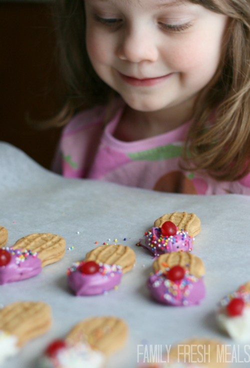 Girl sitting, smiling at Ice Cream Cookies