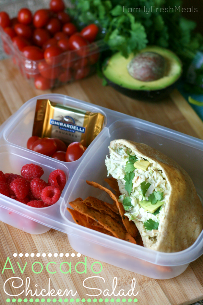 Avocado Chicken Salad in a pita, packed in a lunchbox with fruit and a piece of chocolate