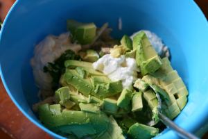 Healthy Avocado Chicken Salad ingredients in a large mixing bowl