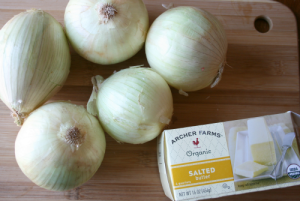 onions and pack of butter on cutting board