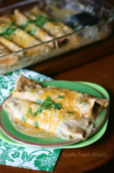 Avocado Chicken Enchiladas - with Vegetarian Friendly option cooked and served on a green plate
