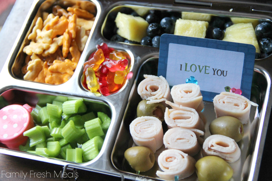 metal lunchbox packed with kid friendly food