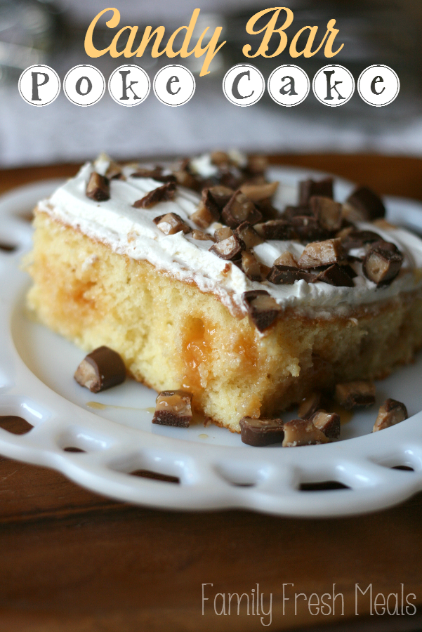 Piece of Candy Bar Poke Cake on a white plate