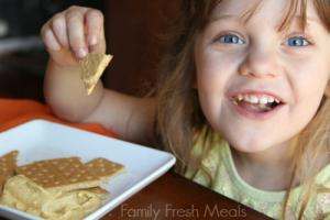 Child eating Pumpkin Cheesecake Dip