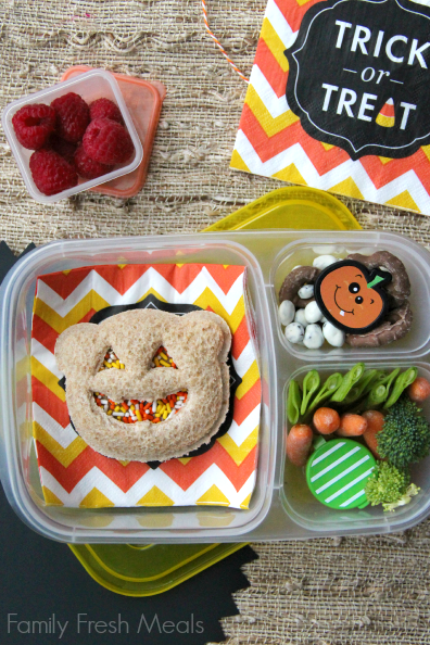 Almond butter sandwich with food sprinkles, yogurt covered raisins, pretzels, fresh veggies with some dip and raspberries.Packed ina lunchbox