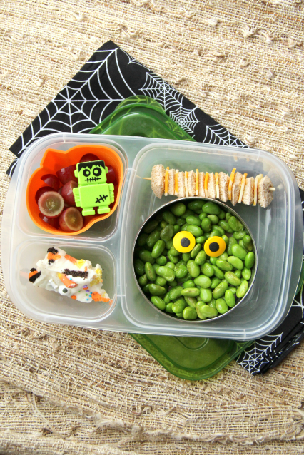 Edamame topped with candy eyes, bread and cheese bites, grapes and a piece of my super yummyHalloween Bark. Packed ina Lunchbox