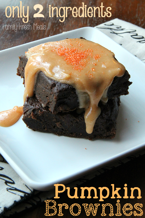 Two Pumpkin Brownies stacked on a white plate