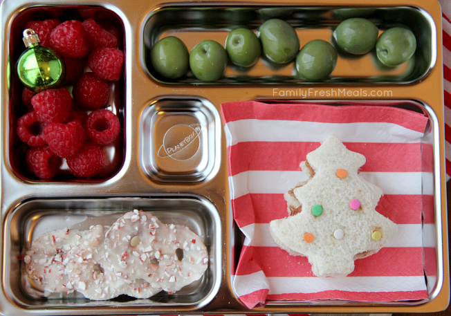 Christmas tree shaped sandwich,  olives, fresh raspberries and some chocolate covered pretzels.  Packed in a Planetbox