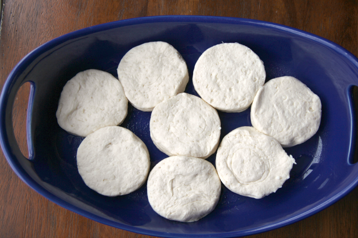 raw biscuits in a blue baking dish