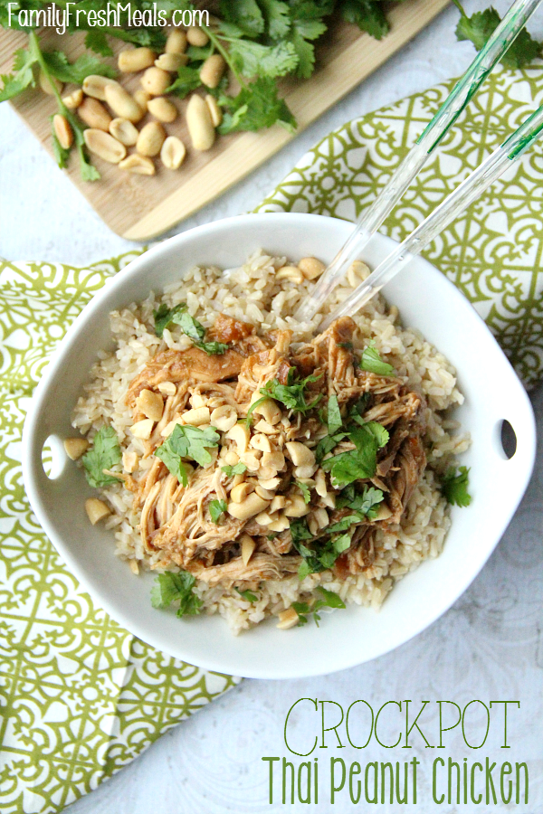 Top down image of crockpot Thai Peanut Chicken served in a white bowl with chop sticks