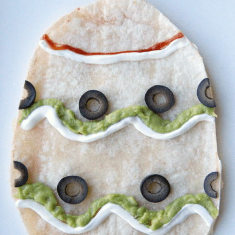 Quesadilla shaped and decorated like an Easter Egg