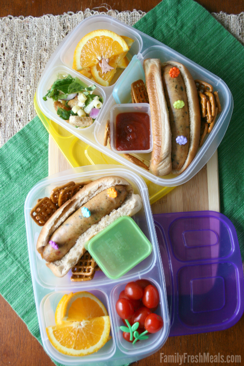 Top down image of 2 lunch boxes with Hot dogs packed for lunch
