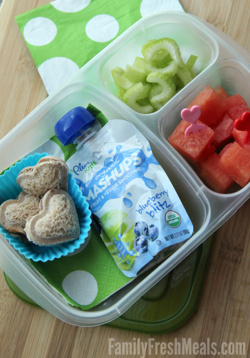 Mini heart Sandwich Pockets, celery and watermelon packed in a lunch box