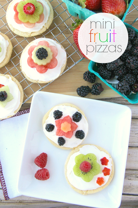 Mini  Fruit Pizza ---- FamilyFreshMeals.com - Fruit pizzas are the best, aren't they? These miniature versions can be assembled before gathering or your can set out plain sugar cookies, the cream cheese topping and a variety of fruit flowers for people to design their mini fruit pizzas. Either way, you have a guaranteed hit both adults and kids will bot LOVE!