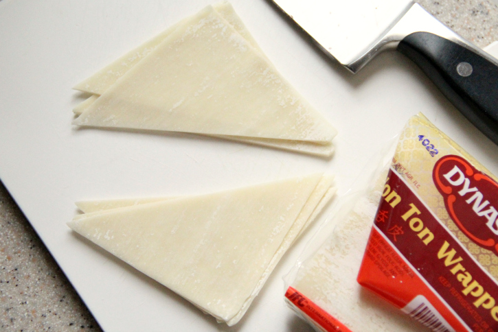 Wonton wrappers cut into triangles