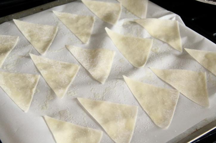Wonton Chips placed on a baking sheet
