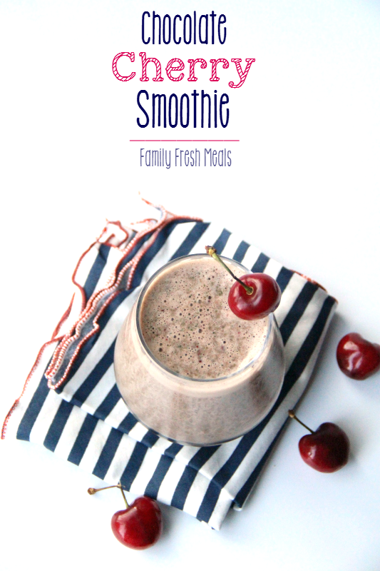 Chocolate Cherry Smoothie in a glass, surrounded by fresh cherries