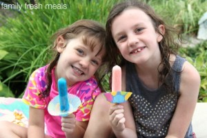 Two children holding popsicles