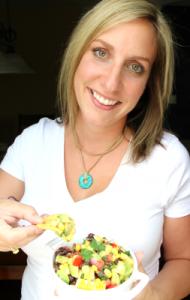 Woman holding a bowl of Cowboy Caviar