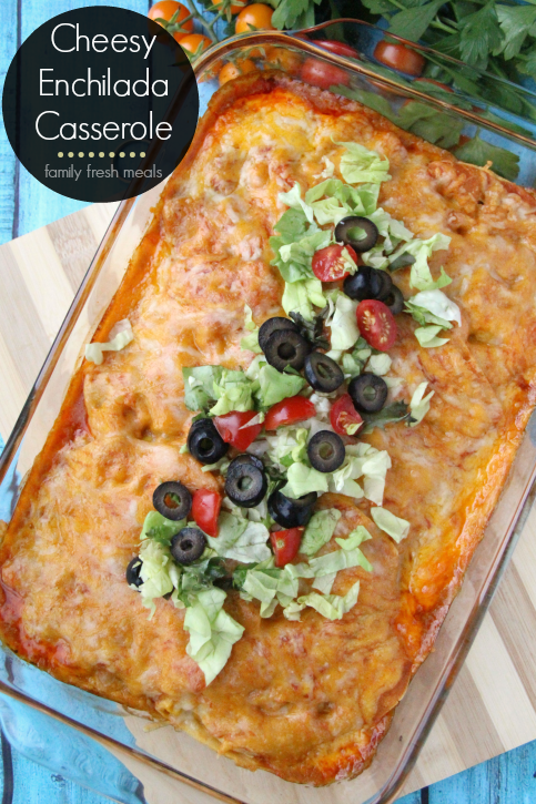 Cheesy Chicken Enchilada Casserole topped with shredded lettuce, sliced black olives and chopped tomatoes