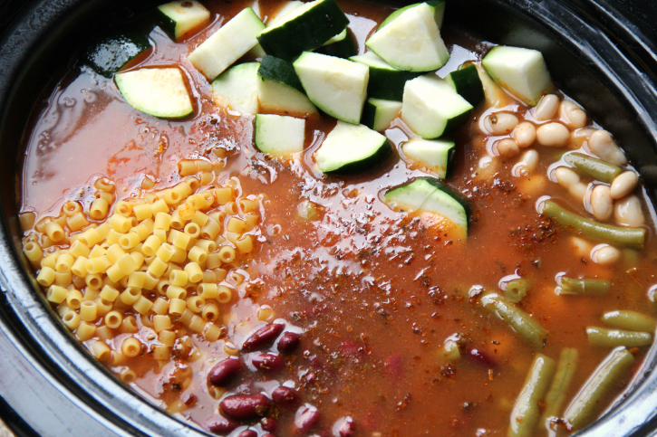 The Best Crockpot Minestrone Soup - Add in noodles, beans and zucchini to slow cooker