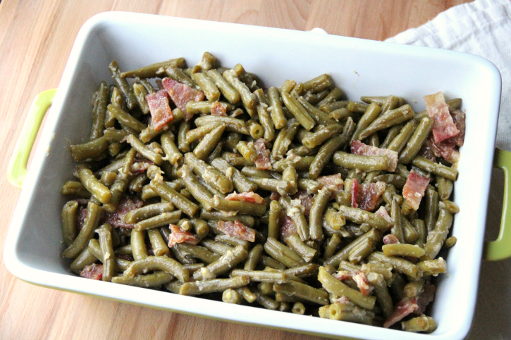 Smothered Bacon Green Bean Casserole in a casserole dish