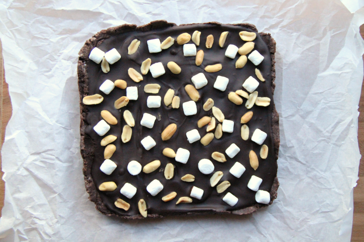 Easy Rocky Road Fudge sitting on parchment paper