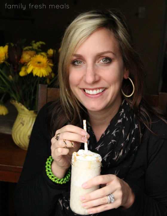 woman holding a smoothie, smiling
