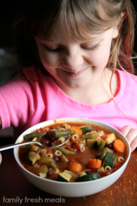 Child eating Crockpot Minestrone Soup