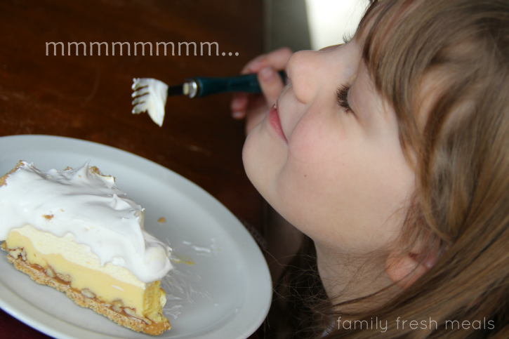 """child eating pie with """"Mmmmmm"""" on the image"""