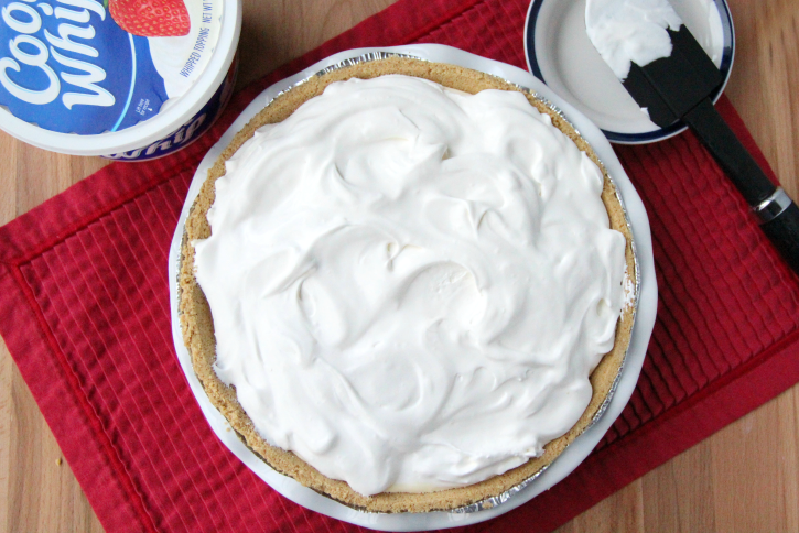 spreading cool whip over putting mixture