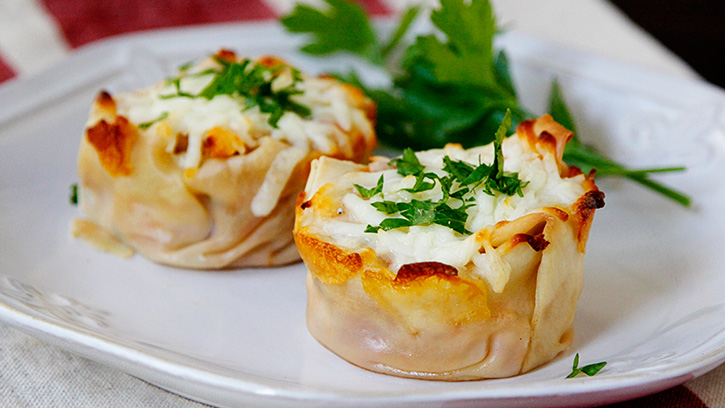 Two Turkey Lasagna Cups on a white plate