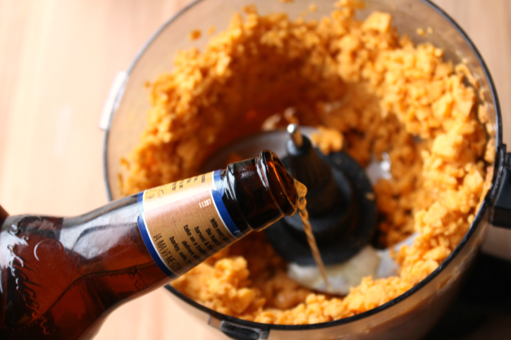 Pub Style Beer Cheese Dip - Pour beer into cheese mix