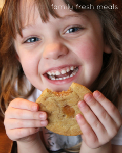 Child eating a Soft and Chewy Double Chip Snickerdoodle Cookie