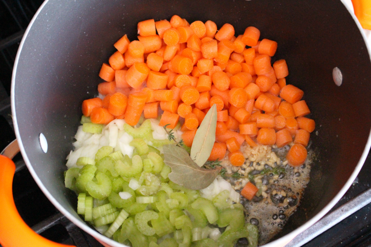 onion, garlic,  celery, carrots, bay leaves, thyme, salt and pepper in a large soup pot