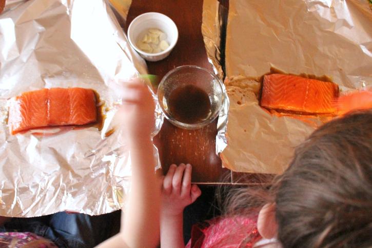 2 children making Easy Salmon Foil Packets