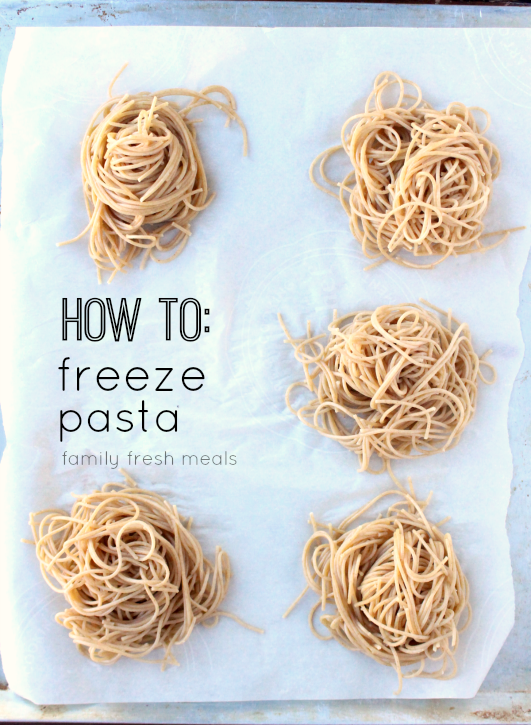 How To Freeze Pasta Portions - 5 piles of pasta on a parchment paper lined baking sheet