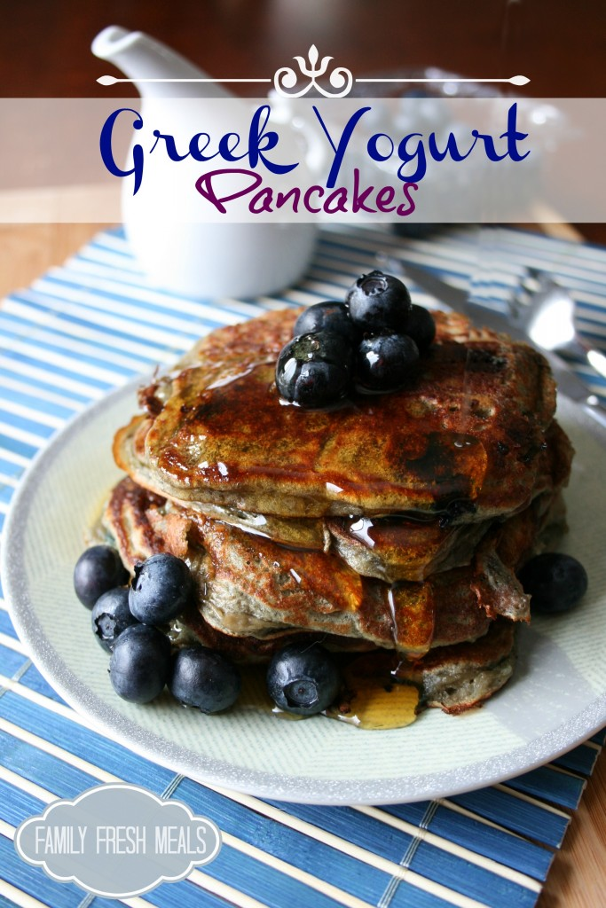 Greek Yogurt Pancakes stacked on a plate with blueberries