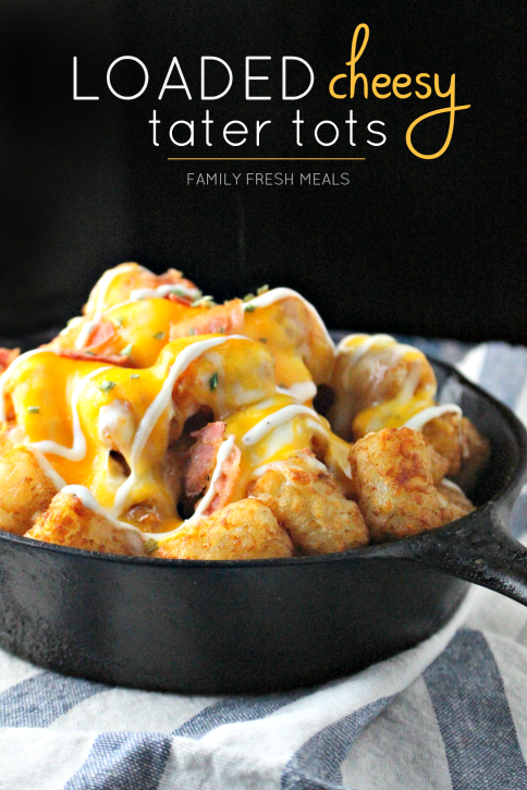 Loaded Cheesy Tater Tots in a cast iron skillet
