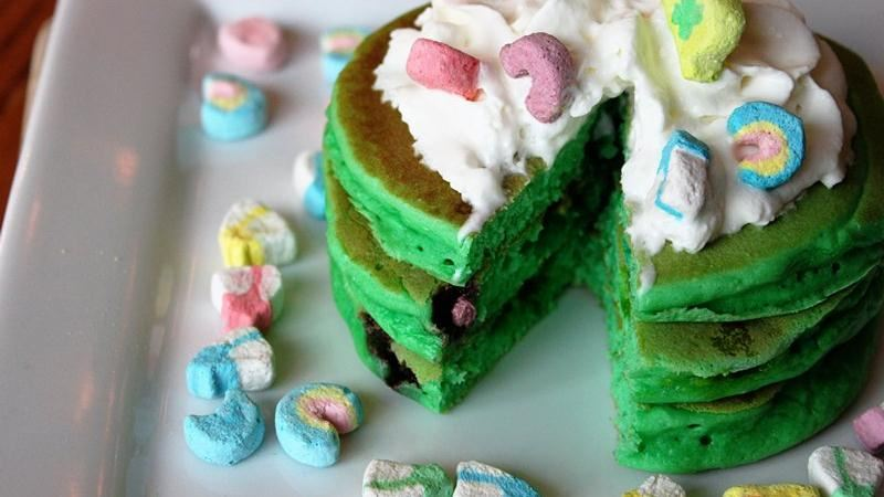 Green Lucky Charms pancakes on a white plate