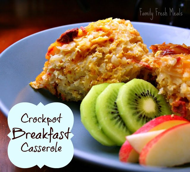 a serving of Crockpot Breakfast Casserole on a plate with fruit