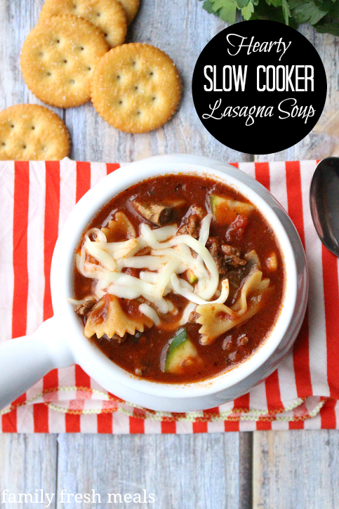 Hearty Slow Cooker Lasagna Soup in a white bowl with a side of crackers