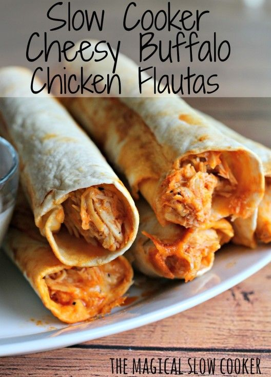 Slow Cooker Buffalo Chicken Flautas  stacked on a white plate