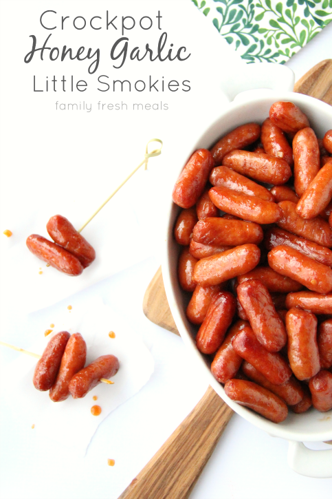 Crockpot Honey Garlic Little Smokies in a serving dish, and on some food picks