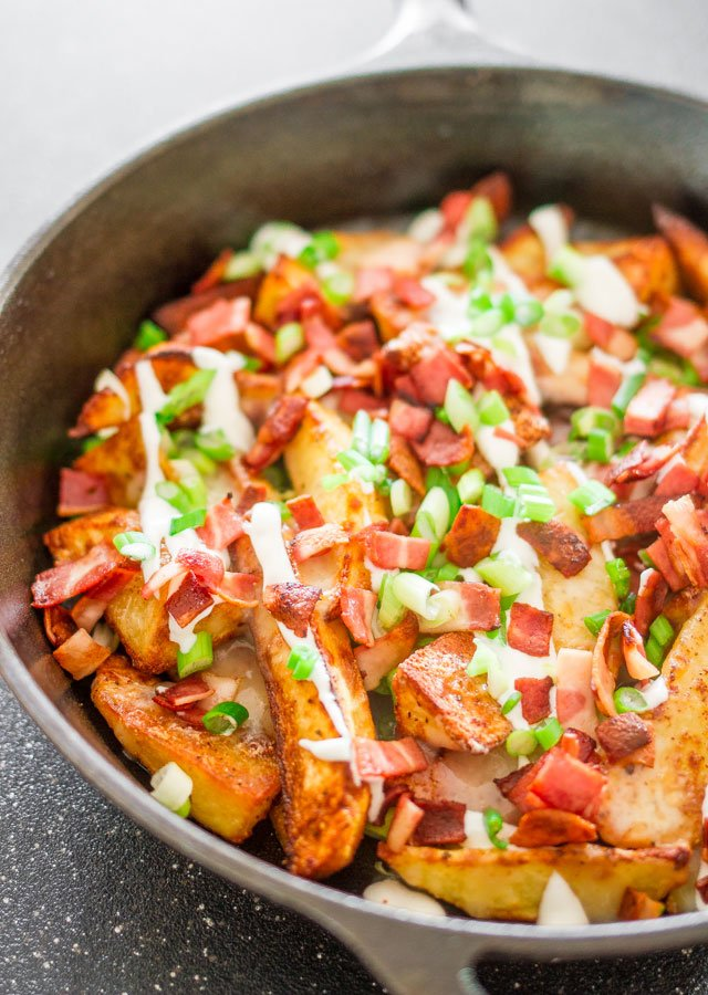 loaded pub fries  in a skillet