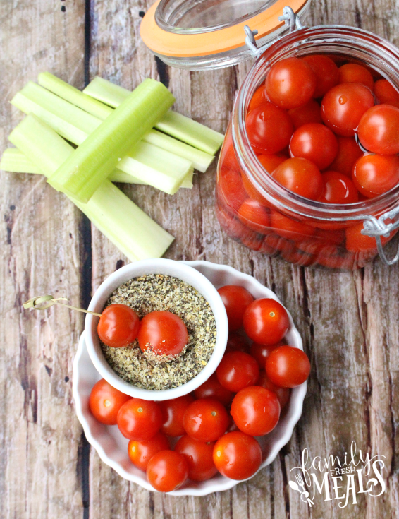 Boozy Bloody Mary Tomato Bombs in a glass jar and in a dish