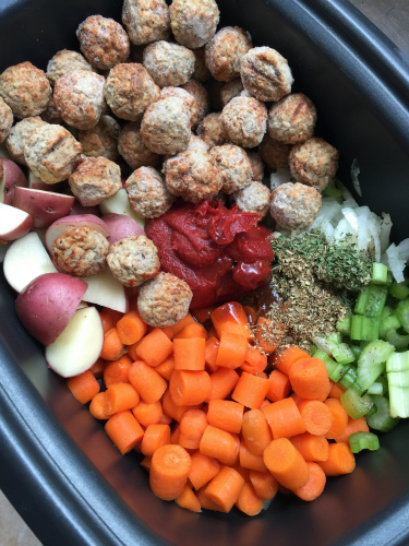 Frozen Meatballs, potatoes, carrots, celery, onion, seasoning, tomato paste in a Slow Cooker